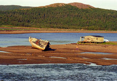 Newfoundland Shipwreck. Old cabin, shipwreck and a boy in Newfoundland cove royalty free stock photos