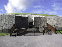 Newgrange entrance. Newgrange is a tomb located in the Boyne Valley, Ireland. It is over 5,000 years old. Newgrange is a World Heritage Site of UNESCO Royalty Free Stock Image