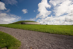 Newgrange monument. Newgrange is a prehistoric monument  located in County Meath, on the eastern side of Ireland, about one kilometre north of the River Boyne Stock Photo