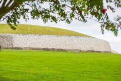 Newgrange Tomb with tree canopy Stock Photo