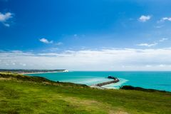 Newhaven harbour from the cliff top. A view of Newhaven harbour England UK, from Fort Hill with the town of Seaford in the distance Royalty Free Stock Images