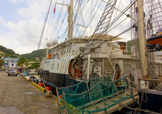 The newly arrived sailing ship tenacious in the windward islands. An historic british tall ship used for the training of sailors visiting port elizabeth, bequia Royalty Free Stock Photo
