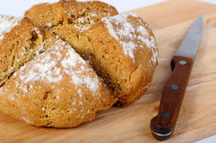 Newly-baked bread and a knife Royalty Free Stock Photo