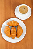 Newly-baked croissants and cup of coffee. Stock Image