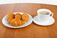Newly-baked croissants and cup of coffee. Stock Photography