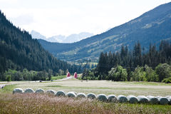 Newly baled hay along Austrian B107 road Stock Photos