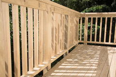 New deck patio built of wood, pine timber Royalty Free Stock Photos