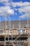 Newly build home in scaffolding UK stock photography