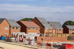 Newly build homes, construction site UK. Newly build houses under construction in Cheshire England United Kingdom royalty free stock photography