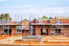 Newly build homes under construction UK. Newly build homes in scaffolding in Cheshire England United Kingdom Europe royalty free stock image