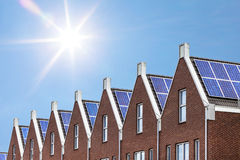 Newly build houses with solar panels attached on the roof. Against a sunny sky Royalty Free Stock Images