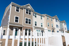 Newly build townhouses with vinyl siding. And picket fence Stock Photos