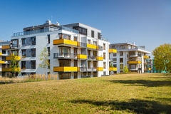 Newly built blocks of flats. With green meadow royalty free stock photography