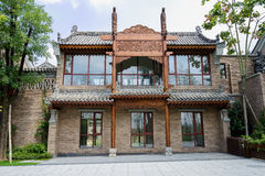 Newly built Chinese traditional building by street on slope Stock Images