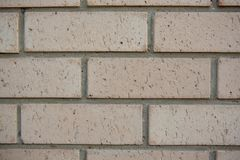 A newly built cream brick wall close up as a texture in South Au. Stralia on 29th August 2018 stock photo