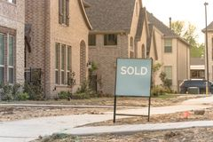 Newly built detached single-family home sold out in America. Close-up front porch of newly built detached single-family home with sold out sign. Brand new royalty free stock photo