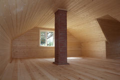 Newly built and faced attic with brick chimney Stock Images