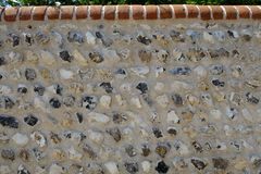 Newly built flint wall. Walls in Sussex are built and the craft is preserved. Newly built flint wall in the South National Downs area of Sussex. Beautiful stock photography