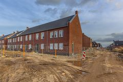 Newly built houses on building site. Newly built houses in modern street building site in suburb of city in the Netherlands stock images