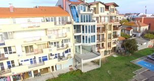 Newly built houses on the seaside boulevard Yavorova in the old Pomorie in Bulgaria stock video footage