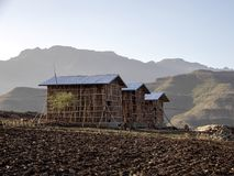 Newly built small houses in a mountainous landscape in northern Ethiopia. The Newly built small houses in a mountainous landscape in northern Ethiopia stock photos