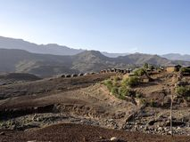 Newly built small houses in a mountainous landscape in northern Ethiopia. The Newly built small houses in a mountainous landscape in northern Ethiopia royalty free stock photo