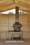 Newly built stone grill in a wooden pavilion Stock Images