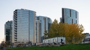 Newly built waterfront high rise apartment complexes. Portland, OR / USA - November 19 2018: Newly built waterfront high rise apartment complexes and office royalty free stock photography