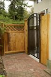 Newly Completed Fence and Gate. Newly constructed fence and gate enclose a yard Stock Photos