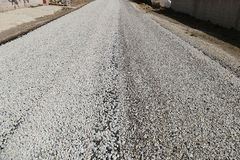 Newly constructed asphalt road works, pitch and road stock photos