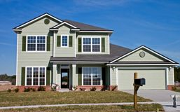 Newly constructed home. Green siding Royalty Free Stock Photo