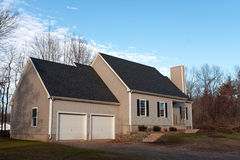 Newly Constructed Home with Two Car Stock Photo