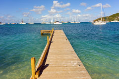 A newly constructed jetty in the windward islands. A wooden dock for yacht dinghies at plantation house, bequia royalty free stock photography