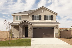 Newly Constructed Modern Home Facade. A Newly Constructed Modern Home Facade and Yard Stock Photos