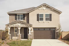 Newly Constructed Modern Home Facade. A Newly Constructed Modern Home Facade and Yard Royalty Free Stock Images