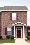 Newly constructed townhome. Suburban townhome complex is ready to receive its first occupants. Focus in this image is on a single unit Royalty Free Stock Photography