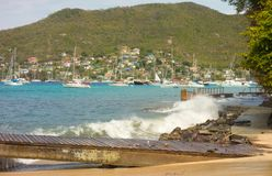 Unseasonal waves crashing against the shore in admiralty bay, bequia Stock Images