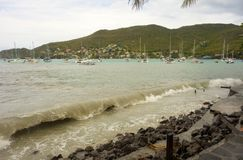 Unseasonal waves crashing against the shore in admiralty bay, bequia Royalty Free Stock Images