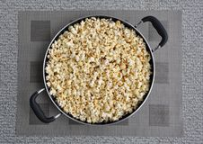 Newly cooked popcorn in a pan Stock Photos