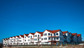 Apartments building complex. A newly developed apartments building with clear blue sky royalty free stock photo