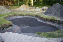 A newly dug in-ground pool Royalty Free Stock Photo