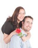 Newly engaged couple. Beautiful couple newly engaged with a rose royalty free stock photo