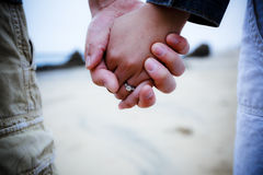 Newly engaged couple holding hands Stock Photos