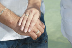 Newly engaged couple showing off their rings Stock Photos