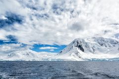 Newly fallen snow covers the mountains in Antarctic peninsula Stock Photo