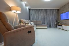 Newly furnished living room with white floor. And gray decorations royalty free stock images
