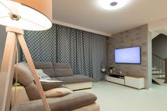 Newly furnished living room with white floor. And gray decorations royalty free stock image
