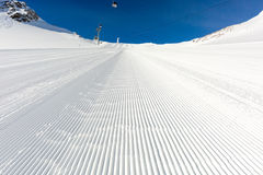 Newly groomed ski slope on a sunny day Stock Photography