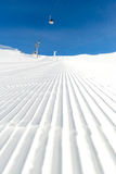 Newly groomed ski slope on a sunny day Royalty Free Stock Image