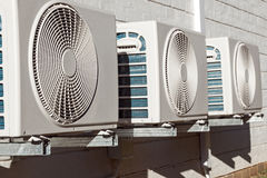 Newly Installed Airconditioning Units Mounted on Brick Wall Royalty Free Stock Photography